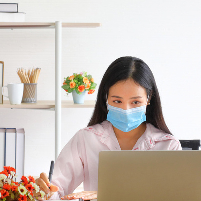 Career_woman_mask_laptop_home_GettyImages